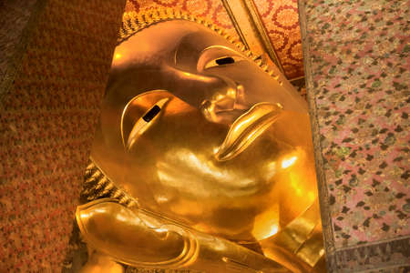 WAT PHO, BANGKOK, THAILAND, 26 SEPTEMBER 2014: Low angle head shot of Wat Pho\'s Reclining Buddha