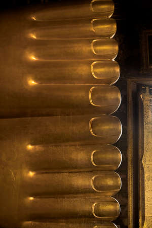 WAT PHO, BANGKOK, THAILAND, 26 SEPTEMBER 2014: Low angle view underthe feet and toes of Wat Pho\ Editorial