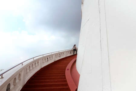 TEMPLE OF THE GOLDEN MT., BANGKOK, THAILAND, 28 SEPTEMBER 2014: A Thai woman climbs up the stairs leading to the top of the Golden Mt. Temple