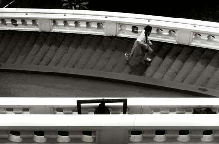 TEMPLE OF THE GOLDEN MT., BANGKOK, THAILAND, 28 SEPTEMBER 2014: A tourist from China runs up the stairs leading to the top of the Golden Mt. Temple
