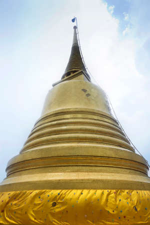 TEMPLE OF THE GOLDEN MT., BANGKOK, THAILAND, 28 SEPTEMBER 2014: A large, golden chedi (stupa) sits at the top of Wat Saket, also known as the Golden Mt. Temple in Bangkok