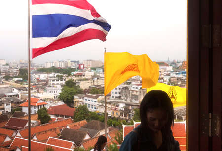 TEMPLE OF THE GOLDEN MT., BANGKOK, THAILAND, 28 SEPTEMBER 2014: Two visitors wakl to the top of the Temple of the Golden Mt. overlooking Bangkok Editorial