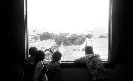 TEMPLE OF THE GOLDEN MT., BANGKOK, THAILAND, 28 SEPTEMBER 2014: A mother and her sons look out over Bangkok from the top of the Golden Mt. Temple 報道画像