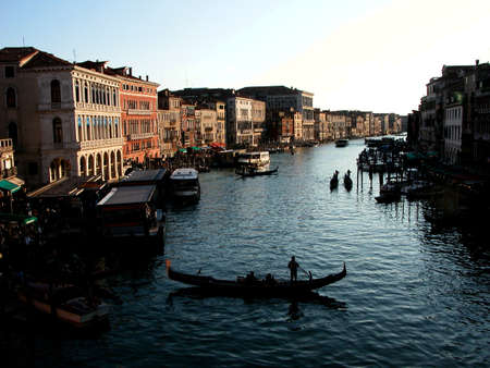 travel features: gondoliers gather in canals of venice transporting tourists from port to