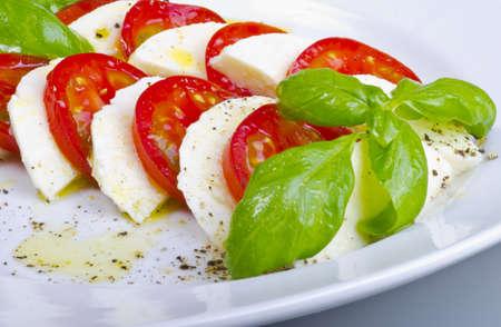 to refine: refine summery Tometen plate with Bazylikum and mozzarella cheese