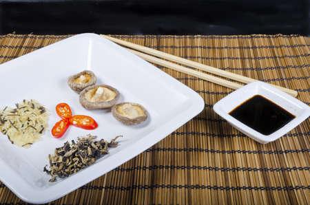 err: Rice and mushroom and Shiitake has young zwibel on plate with Mu Err
