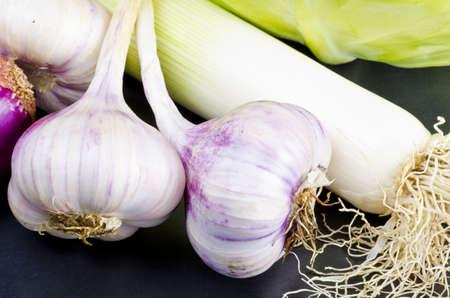 an autumnal cabbage, garlic and leek gem�se kompozition photo