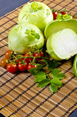 Kohlrabi, tomatoes and young peas photo