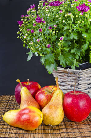 Basket with flowers and fresh fruits photo