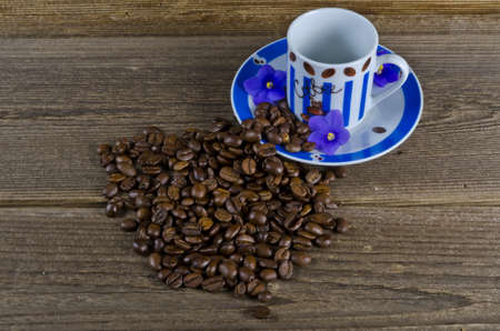 A coffee cup may refer to a type of container from which coffee is consumed.  photo