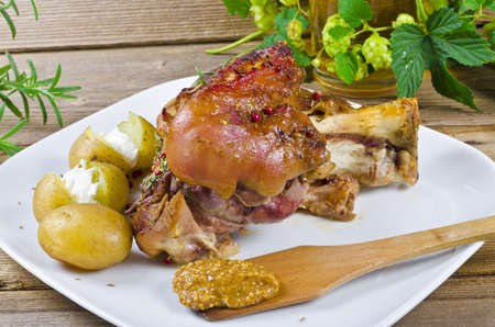 Roasted pork knuckle. Ham and bacon are popular foods in the west, and their consumption has increased with industrialisation. photo