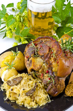 german food: Roasted pork knuckle. Ham and bacon are popular foods in the west, and their consumption has increased with industrialisation.