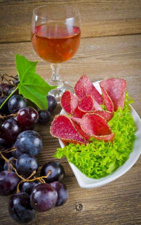 Best Pepper salami and bunches of grapes photo