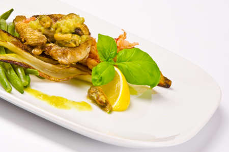 Roasted Dorade with seafood and French beans photo