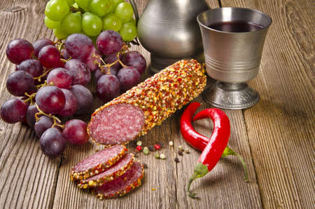 pewter mug: pepper salami Stock Photo