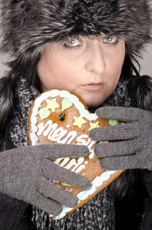 woman with gingerbread heart photo
