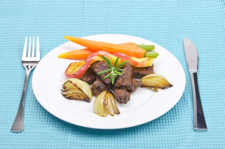 roasted liver with vegetables and apple photo