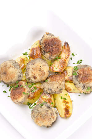 champignon frying pan with potato photo
