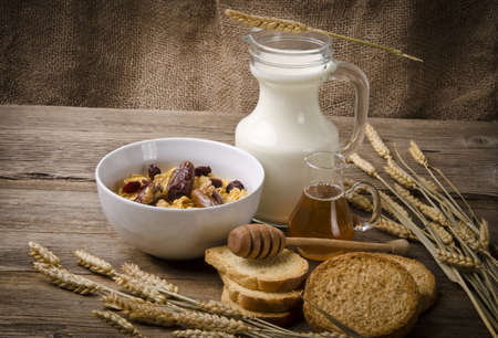Muesli with low-fat milk and rusk Stock Photo