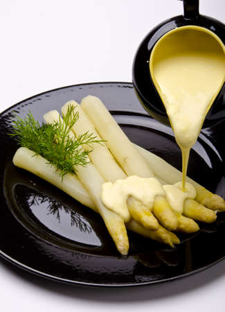 Asparagus, ham and sauce hollandaise photo