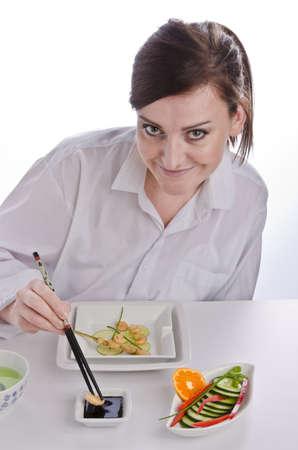 Woman with chopsticks photo