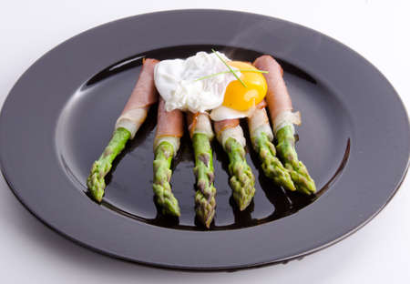 Asparagi with fried egg photo