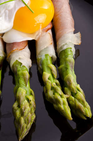 Asparagi with fried egg photo