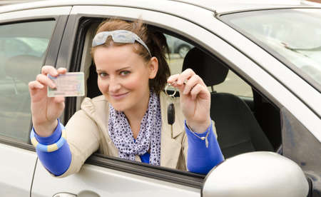 driving school: woman with driving licence