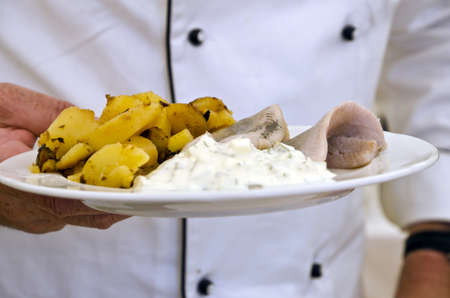 herring with fried potatoes and curd photo