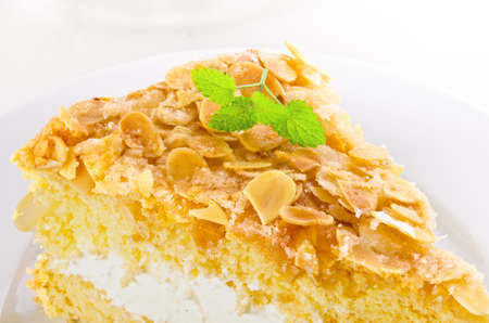 flat cake with an almond and sugar coating and a custard or cream filling Stock Photo - 14399174