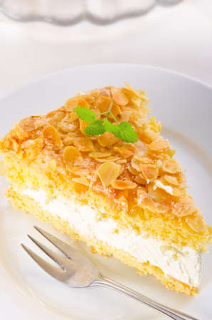 flat cake with an almond and sugar coating and a custard or cream filling Stock Photo - 14399163