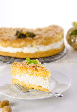 flat cake with an almond and sugar coating and a custard or cream filling Stock Photo - 14399162