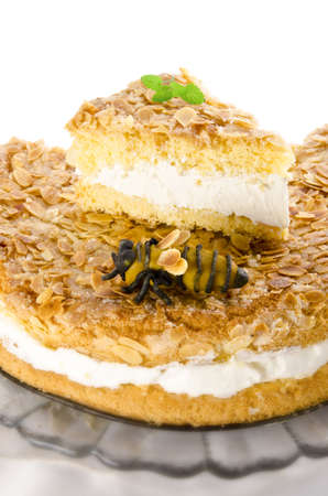 flat cake with an almond and sugar coating and a custard or cream filling Stock Photo - 14399177