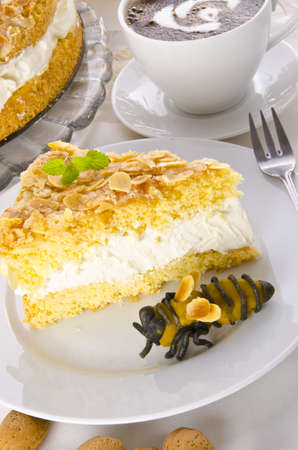 flat cake with an almond and sugar coating and a custard or cream filling Stock Photo - 14399175