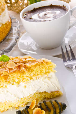 flat cake with an almond and sugar coating and a custard or cream filling Stock Photo - 14399126