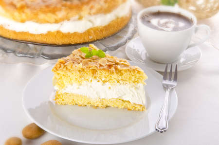 flat cake with an almond and sugar coating Stock Photo - 14433854