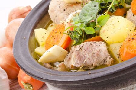 Vegetable stew with meat and herbs photo