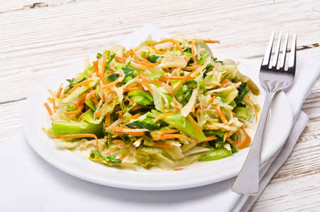 romaine:  Romaine lettuce with carrots and garlic Stock Photo