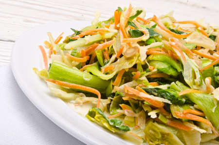 Romaine lettuce with carrots and garlic photo