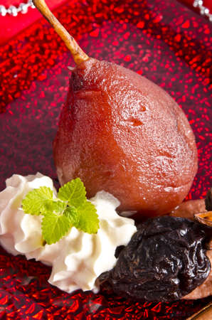 pear helene in red wine with spices photo