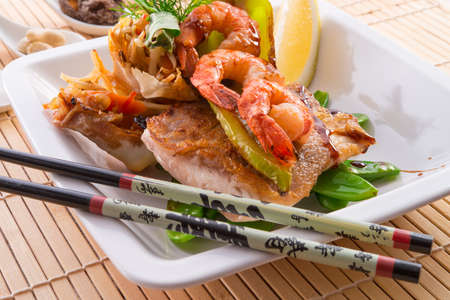 shrimps with fish and vegetables photo