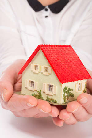 Little House on the hands Stock Photo - 17505452