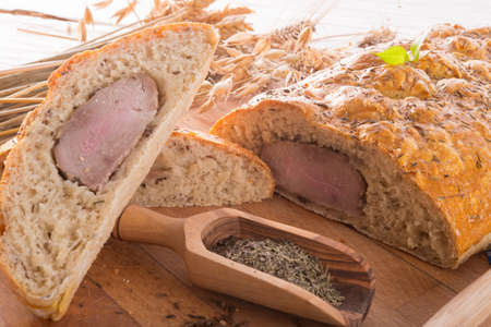 pork fillet in the bread brown photo