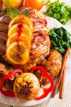baked turkey with chestnut filling and orange photo