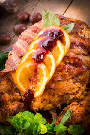 apple christmas: baked turkey with chestnut filling and orange Stock Photo