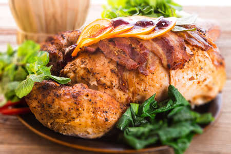 baked turkey with chestnut filling and orange - selective focus