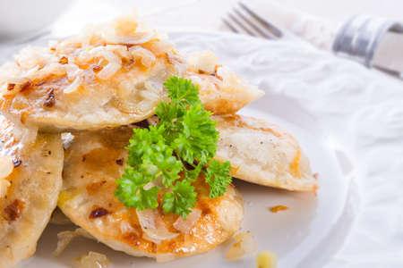 dinnertime: pierogi with meat Stock Photo