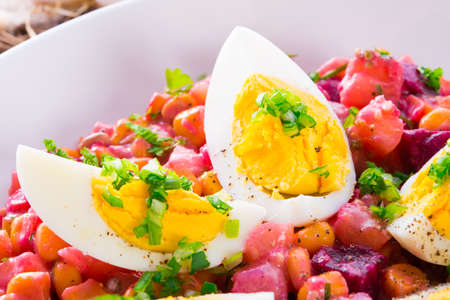 Red beet salad with egg photo