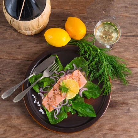 grilled salmon fillets on spinach photo