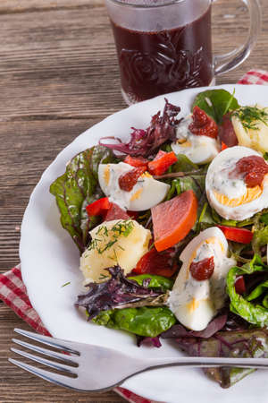 Salad with boiled egg photo